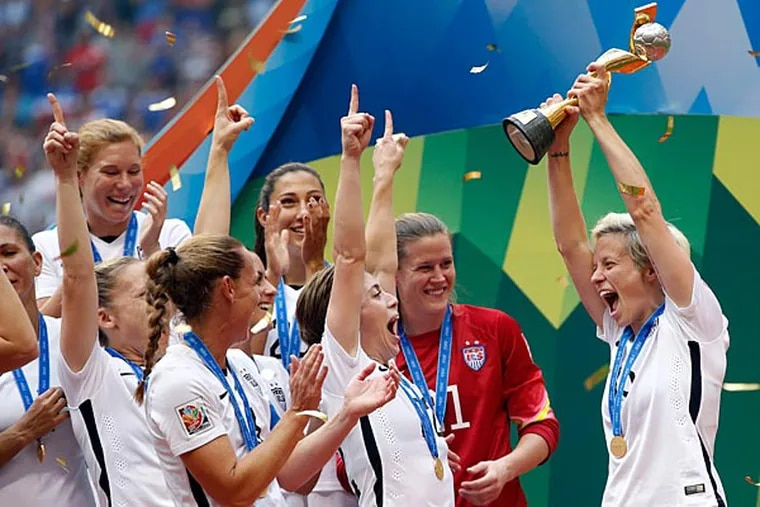 United States midfielder Megan Rapinoe (15) celebrates with teammates after defeating Japan in the final of the FIFA 2015 Women's World Cup at BC Place Stadium. United States won 5-2. (Michael Chow/USA Today)