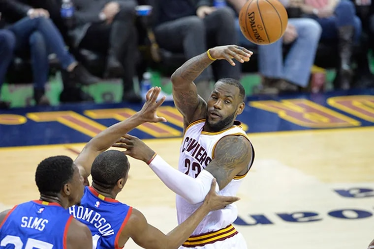 Cleveland Cavaliers forward LeBron James (23) passes in the fourth quarter against the 76ers at Quicken Loans Arena. (David Richard/USA Today)