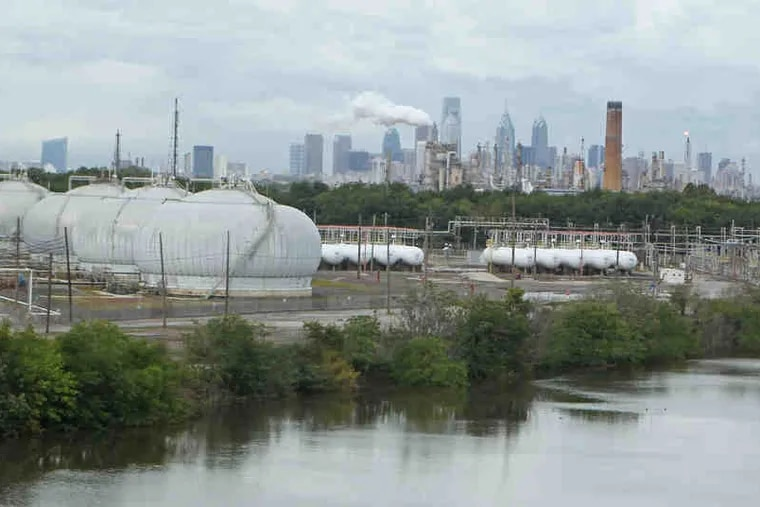Storage tanks sit on the southern bank of the Schuylkill at the Philadelphia Energy Solutions refinery complex in South Philadelphia, which shut down in June after a devastating fire and explosion.