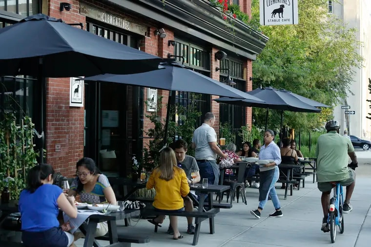 Diners sit outside at Clementine's Stable Cafe along North Broad Street.