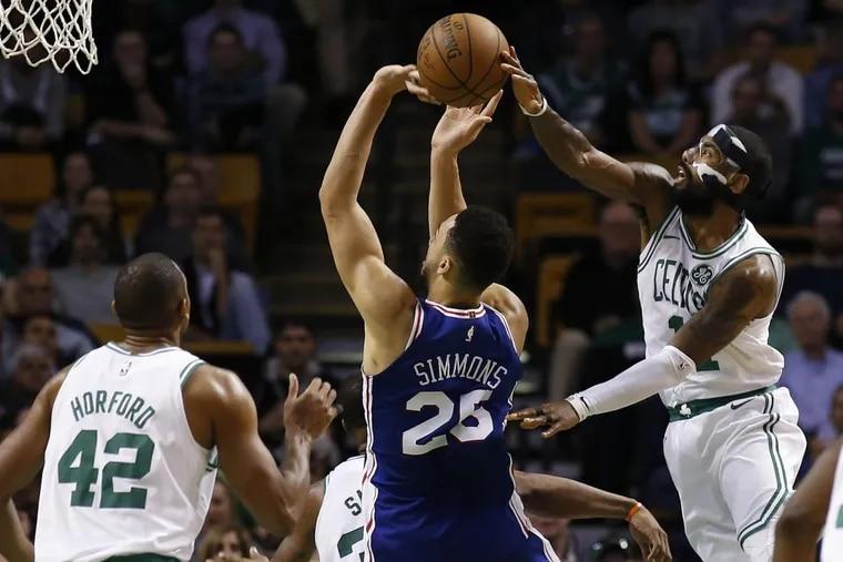 Boston Celtics star Kyrie Irving blocks a shot by the Philadelphia 76ers' Ben Simmons during the fourth quarter of Boston's 108-97 win.