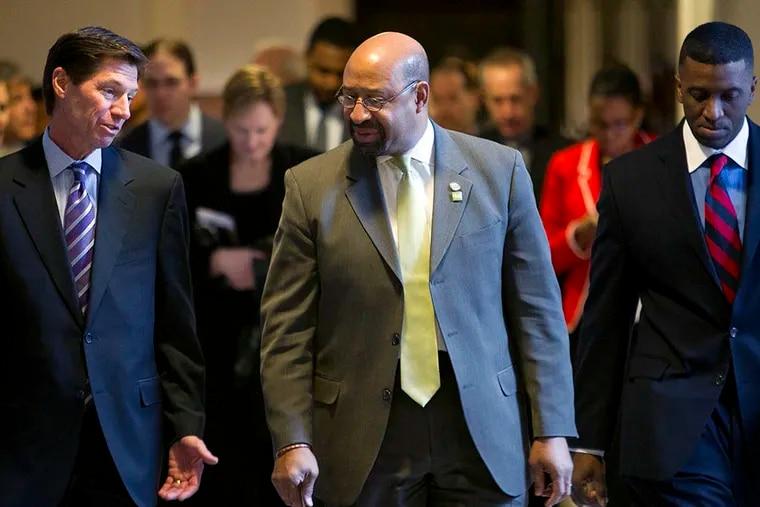 Philadelphia Mayor Michael Nutter, (right), walks with James Torgenson, president of UIL Holding Corp, at Philadelphia City Hall on Monday, March 3, 2014. ( ALEJANDRO A. ALVAREZ / STAFF PHOTOGRAPHER )