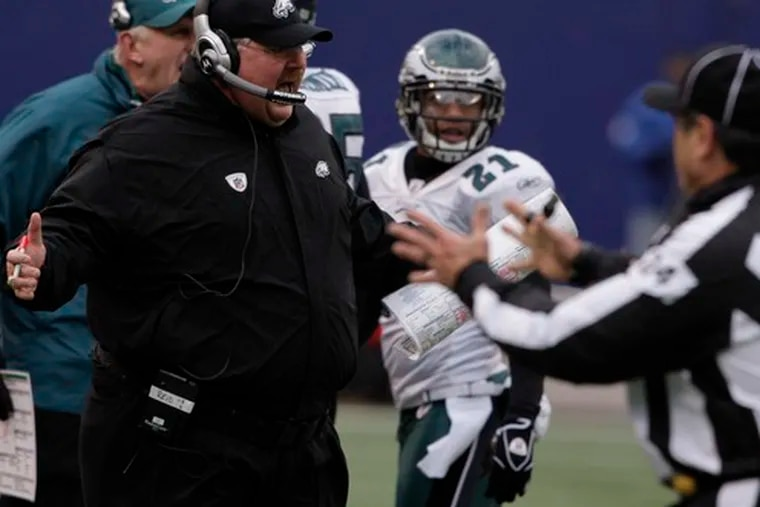 Coach Andy Reid shares his thoughts with an official in the second quarter of the Eagles' victory over the Giants.
