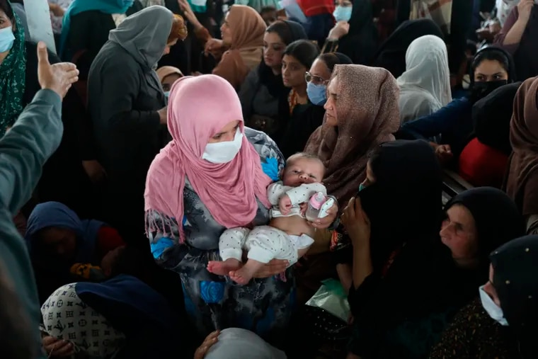 Women wait inside the passport office in Kabul, Afghanistan, on Wednesday, June 30, 2021. Afghans lined up by the thousands at the Afghan passport office to get new passports ahead of the U.S. departure from Afghanistan.