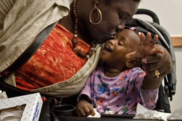 Kassiha Francis gets a kiss from her mother, Jeanette, before surgery in October. The toddler from Grenada died last week.