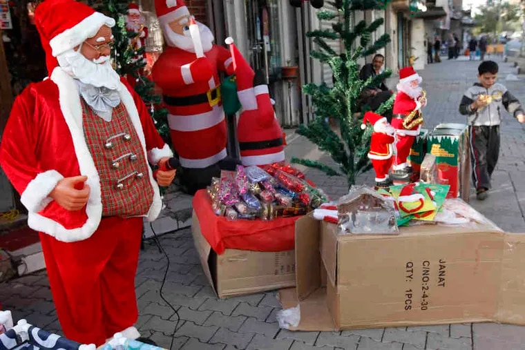 Christmastime paraphernalia on sale in Baghdad. Shop owners said few were buying Christmas trees and Santa Claus toys.