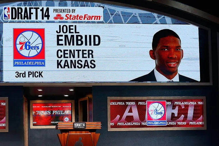 A video screen showed the selection of Joel Embiid of Kansas as the No. 3 overall pick in the first round by the 76ers during the 2014 NBA draft at Barclays Center on June 26, 2014 in Brooklyn.