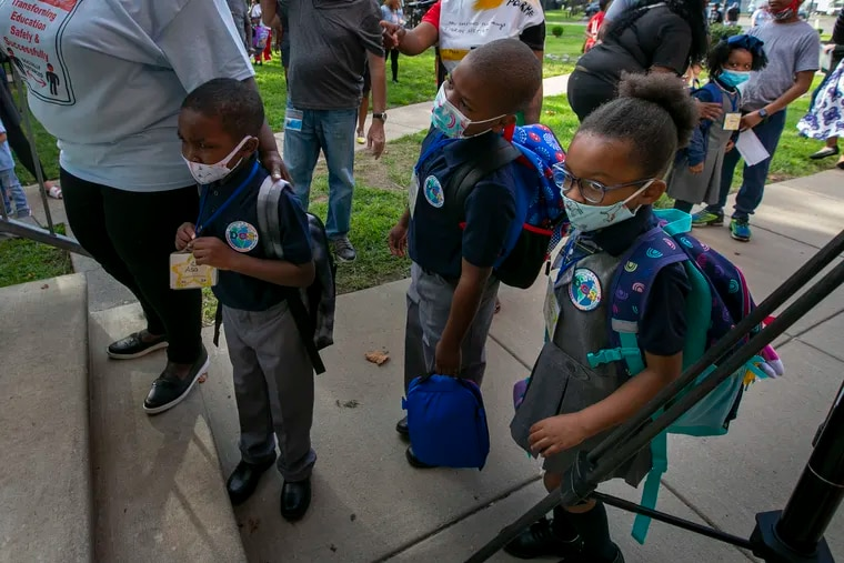 Children with face masks start their first day of school at Discovery Charter School in Philadelphia in August.