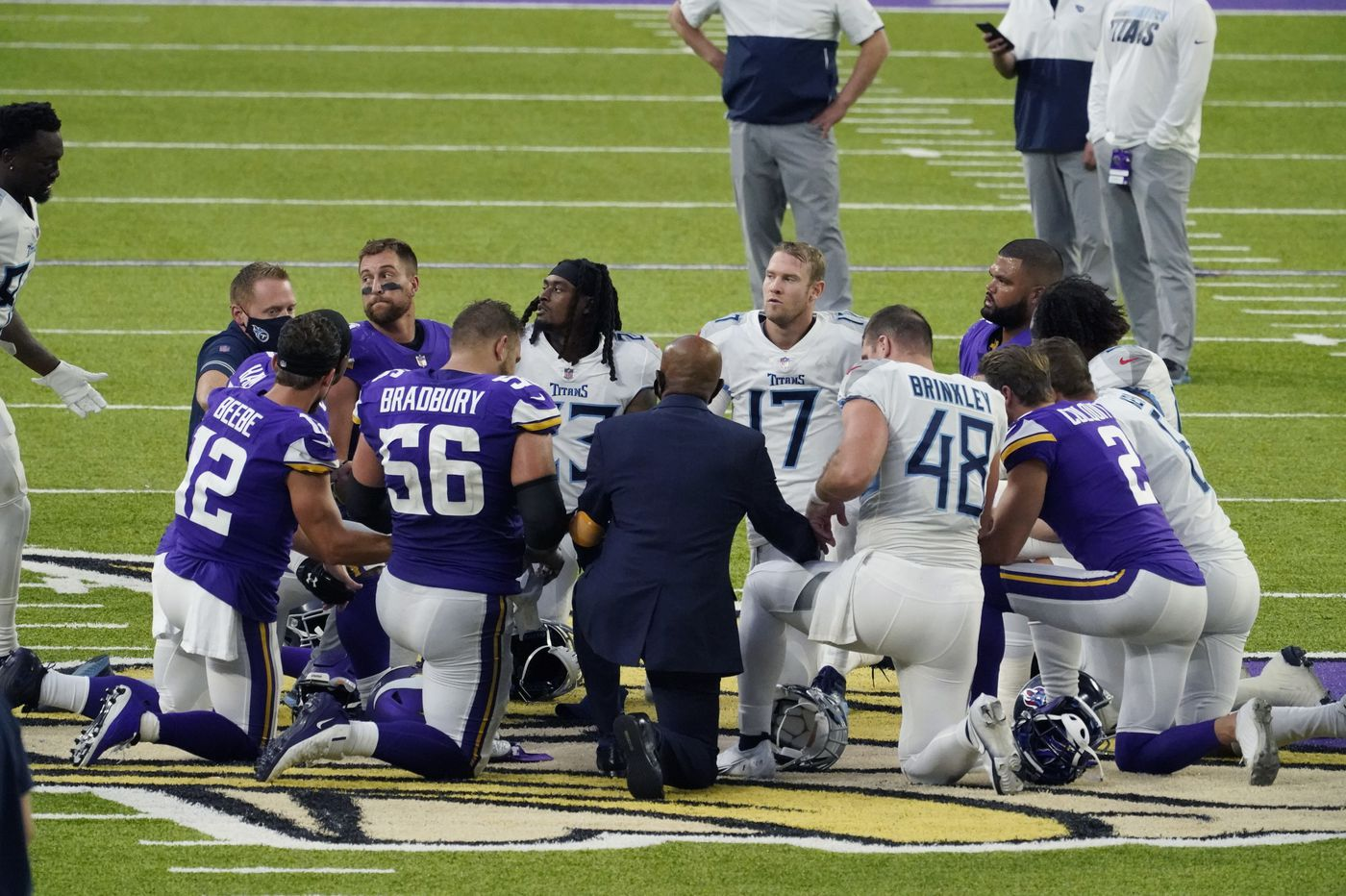 The Tennessee Titans and Minnesota Vikings halt in-person activities because of the NFL season's first COVID-19 outbreak
