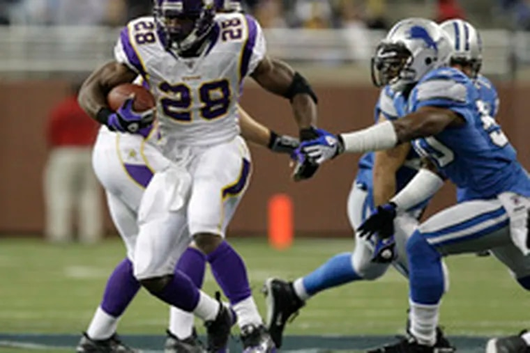 Vikings running back Adrian Peterson tallied a league-best 1,760 yards this season.