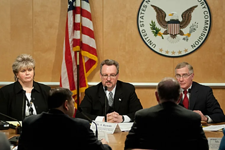 Steven Reynolds, Director, Division of Nuclear Materials Safety, Region III (center), asks questions of the Veterans Administration Medical Center, Philadephia, staff during the US Nuclear Regulatory Commission hearings, Dec.r 17, 2009, on the brachytherapy mistakes made at the Philadelphia Veterans Administration.