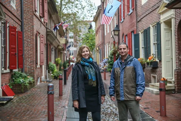 Maiken Scott, left of WHYY and Michael Yudell of Drexel have created a free audio walking tour that chronicles the city's Yellow fever epidemic of 1793. Here at Elfreth's Alley in the Old City neighborhood,  Tuesday,  October 22, 2019.