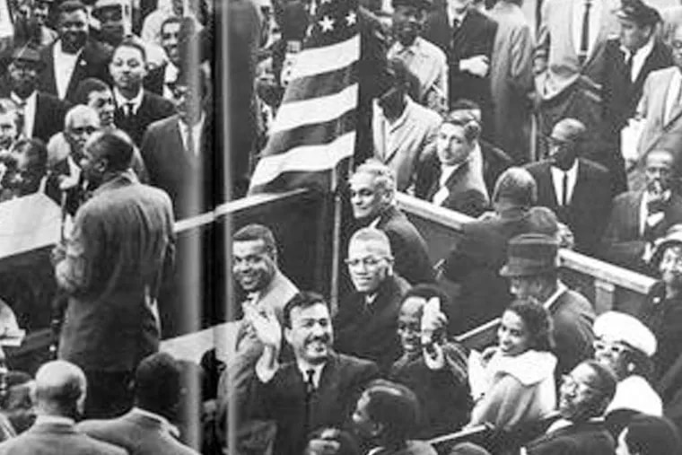 PHOTO COURTESY OF GENE SEYMOUR Among Chuck Stone's intersections with history and those who made it was this event in Harlem, where he sat alongside Malcolm X.