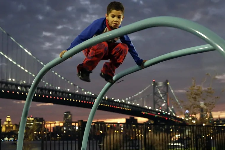 Nine-year-old Jose Reyes of Camden plays at Cooper's Poynt Waterfront Park in Camden.