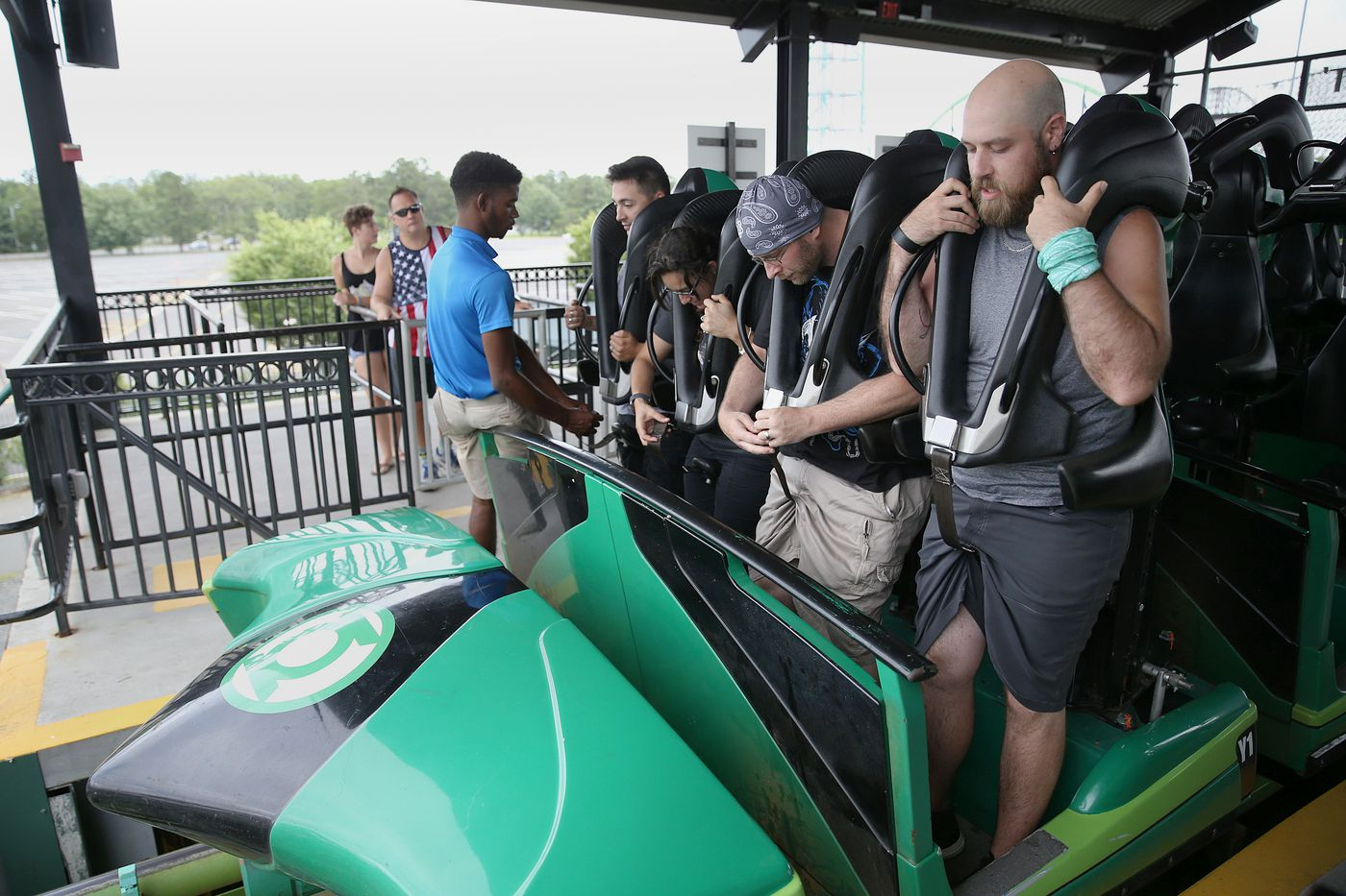James Hanley, of Nyack, N.Y. (right), and his friend Michael Wray, of Yonkers, N.Y. (second from right), prepare to ride the Green Lantern roller coaster at Great Adventure.