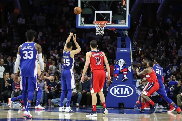 Ben Simmons takes a free throw after getting fouled intentionally by the Wizards in the fourth quarter.