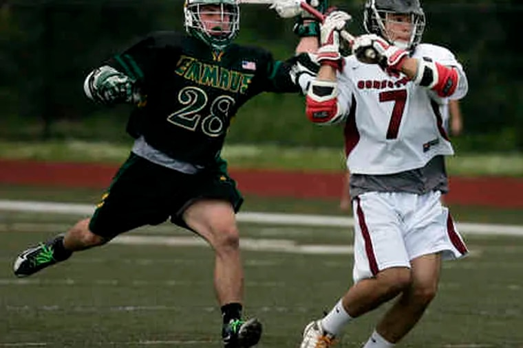 Conestoga's Ryan Buttenbaum gets off a shot despite the efforts of Emmaus' Tate Klidonas in the fourth quarter.After yesterday's PIAA quarterfinal win, Conestoga will play Springfield (Delco) in the semifinals Tuesday.