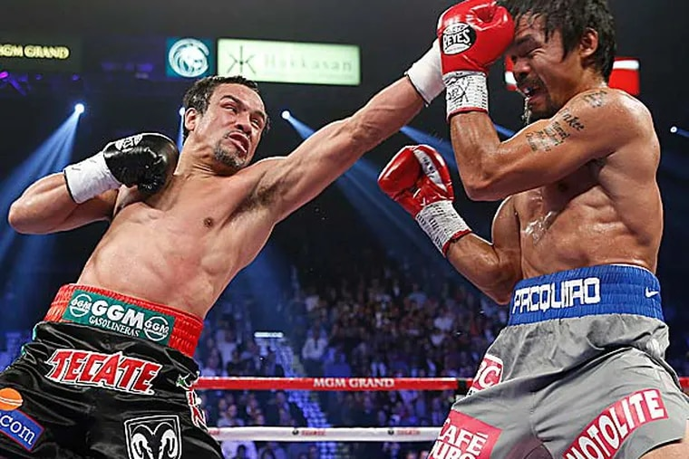 It will go down among the great fights of their era. But it was barely over when the cry arose for Manny Pacquiao and Juan Manuel Marquez to do it again. (Eric Jamison/AP)