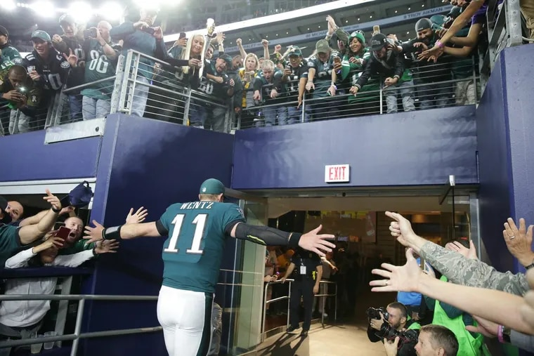 Eagles' Carson Wentz runs off the field after the Eagles 37-9 win over the Cowboys on Sunday.
