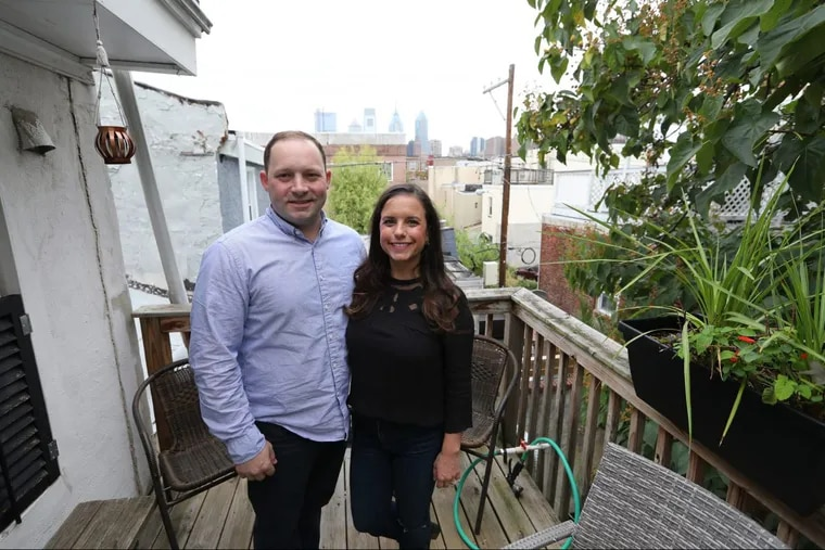 Homeowners Emily Kubick and Mitch Marino say they enjoy gazing at stars or Philadelphia's skyscrapers from the deck of their Graduate Hospital neighborhood trinity.