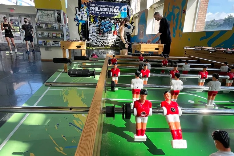 """September 20, 2021: There is action in miniature at the Soccer 2026 Pitch at the visitors center at Independence National Historical Park. It is part of Philadelphia's bid to be chosen as one of 10 cities to host matches when the FIFA World Cup comes to the United States in 2026. Philadelphia Soccer 2026 welcomes the public to play and contribute their own memories to the exhibit (rear) and """"show FIFA and U.S. Soccer the passion of the local soccer community."""""""