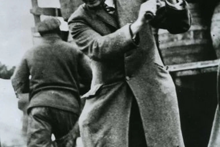 Smedley Butler, Philadelphia's director of public safety during Prohibition, destroys kegs of bootleg beer. Philadelphia and the 18th Amendment didn't mix well.