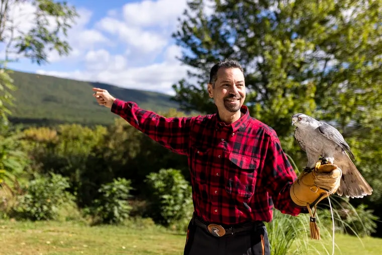 Mike Dupuy, falconer, shows the mountains near his home where he explores looking for nests of goshawks in Middleburg, Pa.