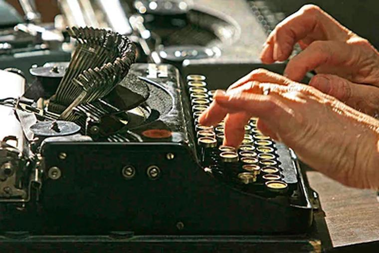 Michael McGettigan tries his hand at a 1925 Remington portable at the first Philadelphia Type-In Saturday at Bridgewater's Pub. (AKIRA SUWA / Staff Photographer)