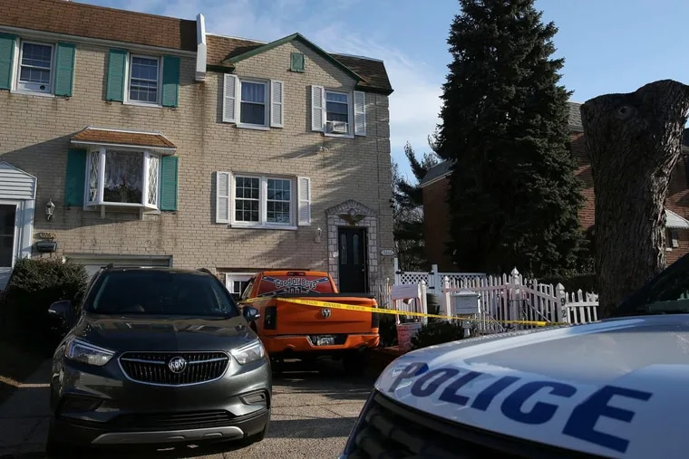 Philadelphia police crime scene tape surrounds the front of a home in the 9200 block of Angus Place in northeast Philadelphia where an 11-year-old girl was found unresponsive after a sleepover on Wednesday, Dec. 27, 2017.