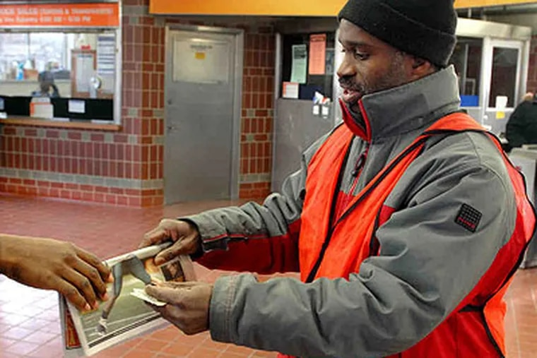 Olaniyan Adefumi sells newspapers at the Fern Rock SEPTA station during the morning rush. A federal magistrate judge was impressed by his self-improvement efforts. (Tom Gralish / Staff Photographer)