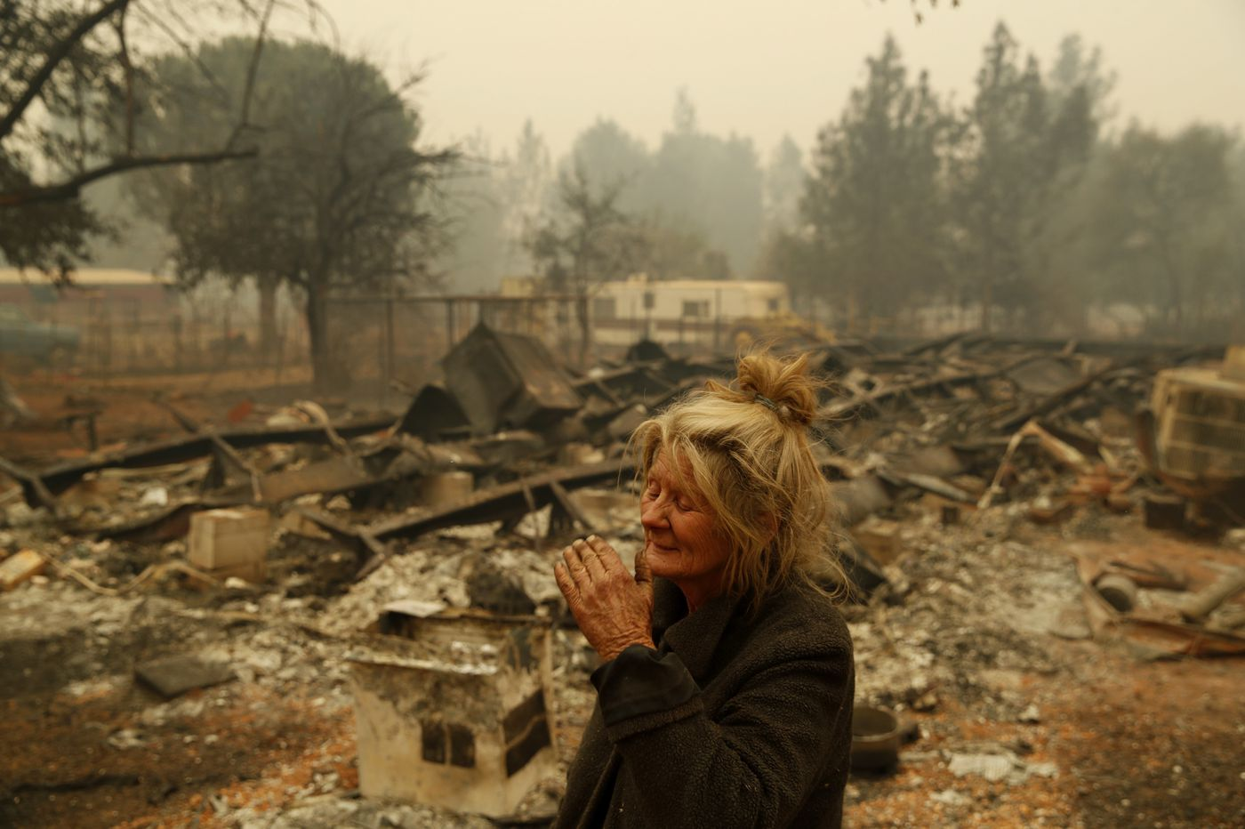 In smoldering wildfire ruins, life goes on for a hardy few