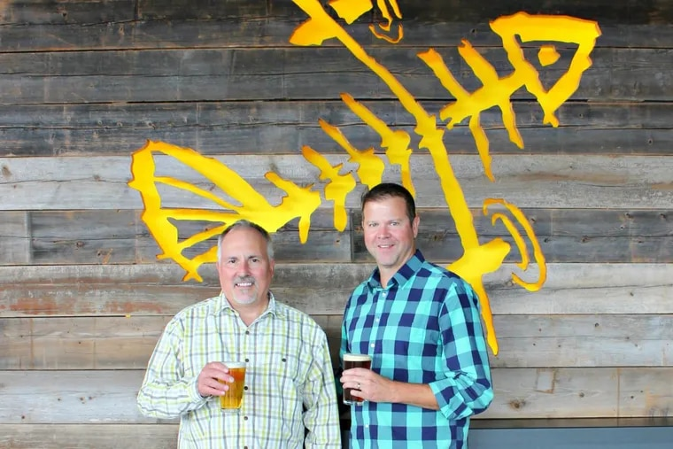 At Flying Fish Brewing Co., founder Gene Muller (left) and chief executive Lou Romano.