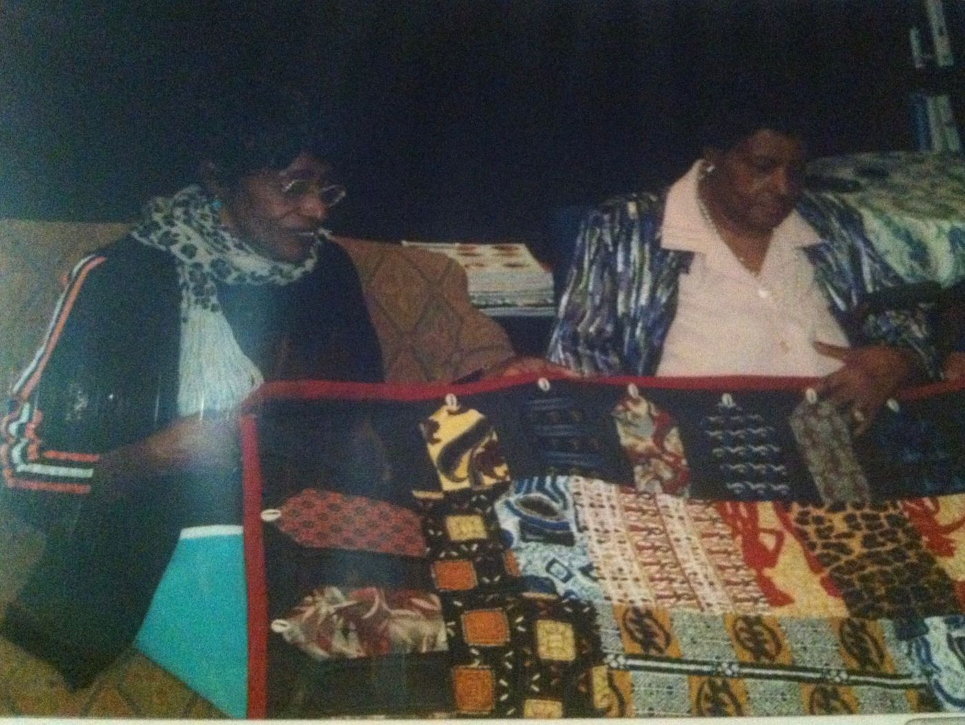 Dorothy Beam (right) looks at the quilt made from the neckties she donated with sister, Margaret Davis (left), who died in 2016.