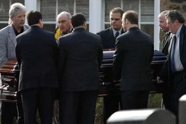 Before he confessed to killing his wife Ellen Gregory Robb, University of Pennsylvania economics professor Rafael Robb helped carry her funeral casket at Radnor Methodist Church in Radnor Pa., on Friday, Dec. 29, 2006. Robb is second from left on the far side of the casket.