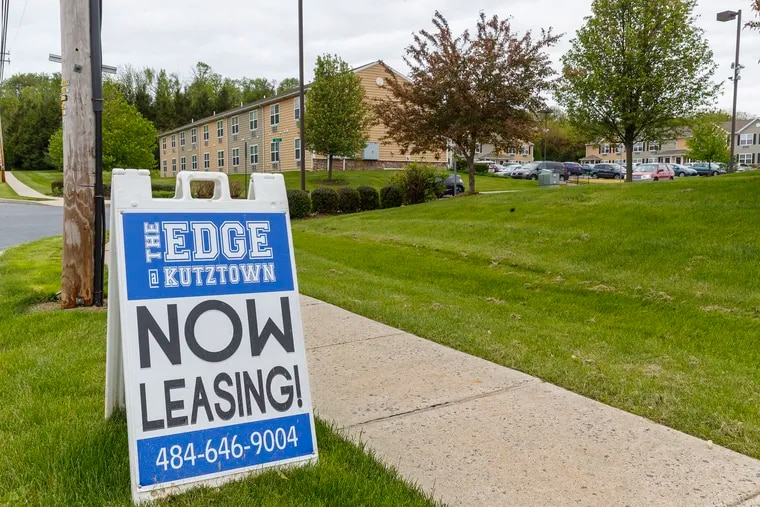 """A """"now leasing"""" sign sits out front of the Edge, a group of student apartments in Kutztown that has fallen into foreclosure as nearby Kutztown University loses students."""