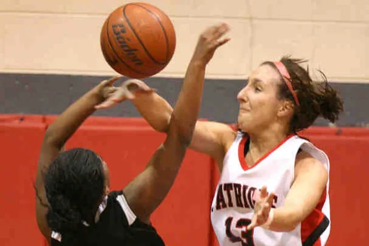 Freire's Taryn Vinson has her shot blocked by Germantown Academy's Alexa Gallagher in the first quarter. Gallagher led the Patriots with 18 points. Vinson scored six.