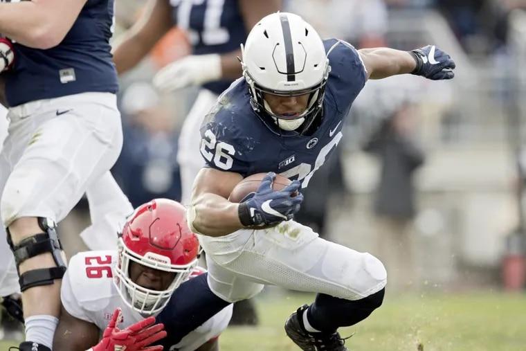 Rutgers defensive lineman CJ Onyechi pulls down Penn State running back Saquon Barkley on Saturday at Beaver Stadium.