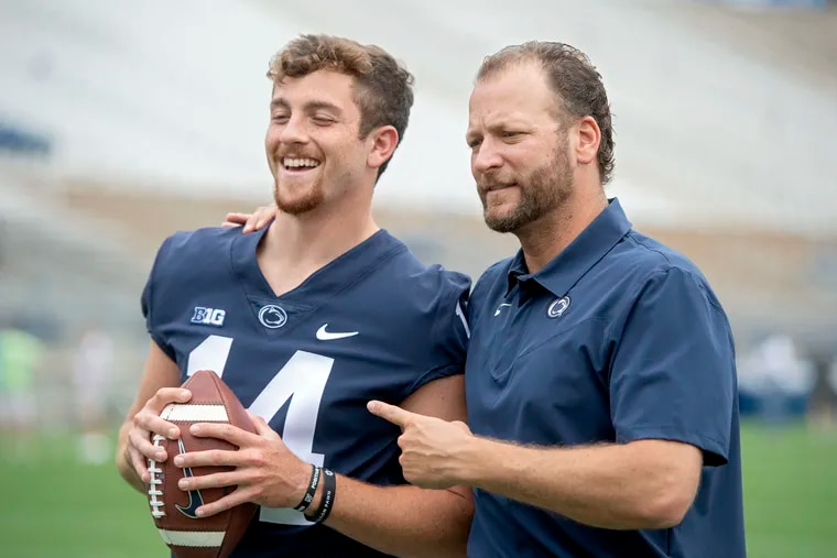 Penn State quarterback Sean Clifford with offensive coordinator Mike Yurcich in August.