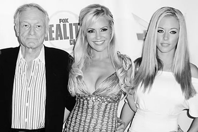 Kendra Wilkinson, right, has changedso much since her engagement to the Eagles' Hank Baskett, says Bridget Marquardt (center). They were withHugh Hefner this year at an awards show.