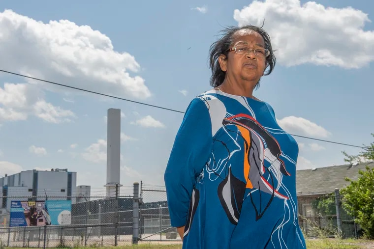 Zulene Mayfield stands in front of the Delaware Valley Resource Recovery Facility in Chester, Pa. Mayfield is a long-time opponent of the facility.