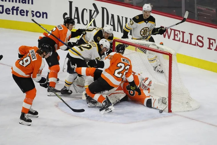 Goalie Brian Elliott makes a save in the line in the first period as the Bruins meet the Flyers at the Wells Fargo Center Saturday Dec. 2, 2017