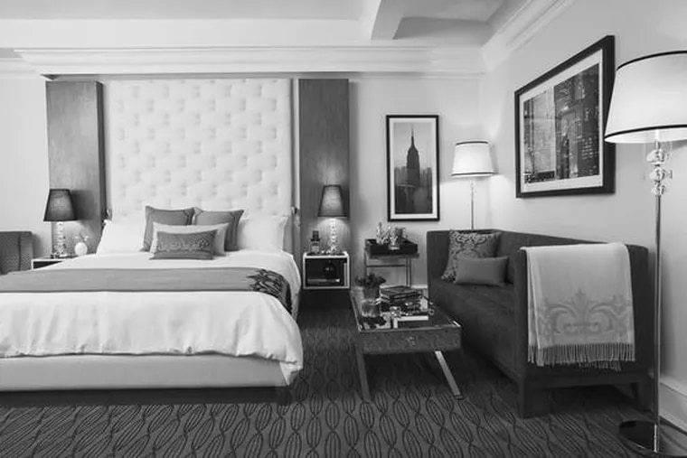 Guest rooms at The Carlton feature leather-tufted headboards.