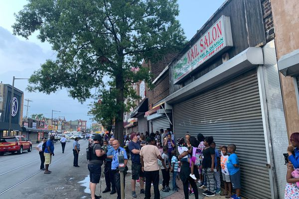After hours of fear, terrified parents comfort children after day-care lockdown near North Philly police shooting