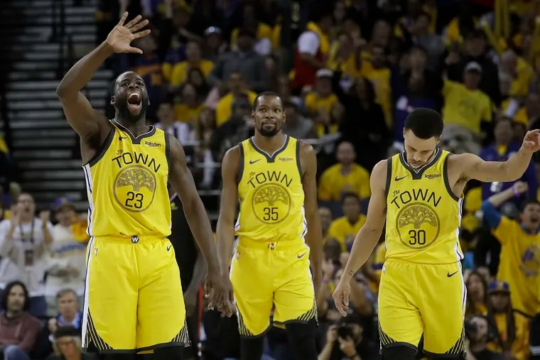 Golden State Warriors forward Draymond Green (23) wasn't pleased with the way Kevin Durant (23) handled his exit. (AP Photo/Jeff Chiu)