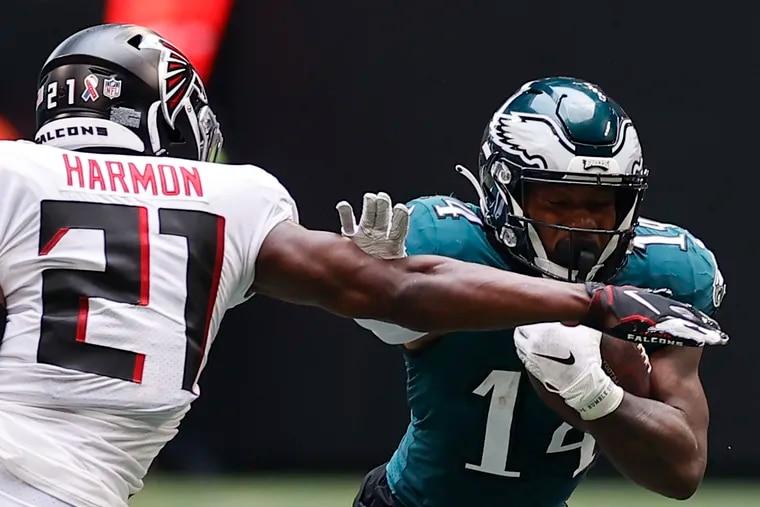 Eagles running back Kenneth Gainwell runs with the football against Atlanta Falcons strong safety Duron Harmon on Sunday, September 12, 2021 in Atlanta.