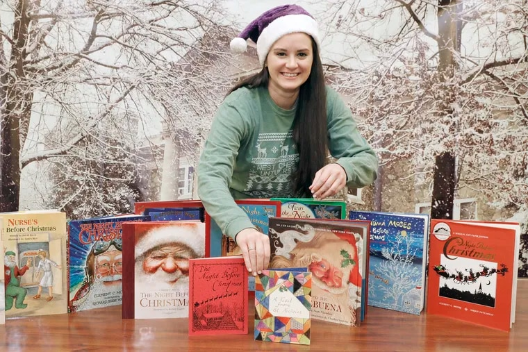 Brigid Gallagher, West Chester University's assistant director of alumni engagement, with the collection of books that were read during the school's virtual holiday storytelling series.