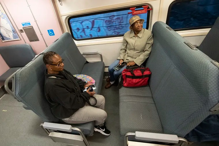 Sisters Jacqueline Robinson (left) and Florence Walker, ride NJ Transit train No. 7861 from 30th Street Station to Atlantic City on Sunday morning. Mother's Day was the first day of restored service on the Atlantic City line.