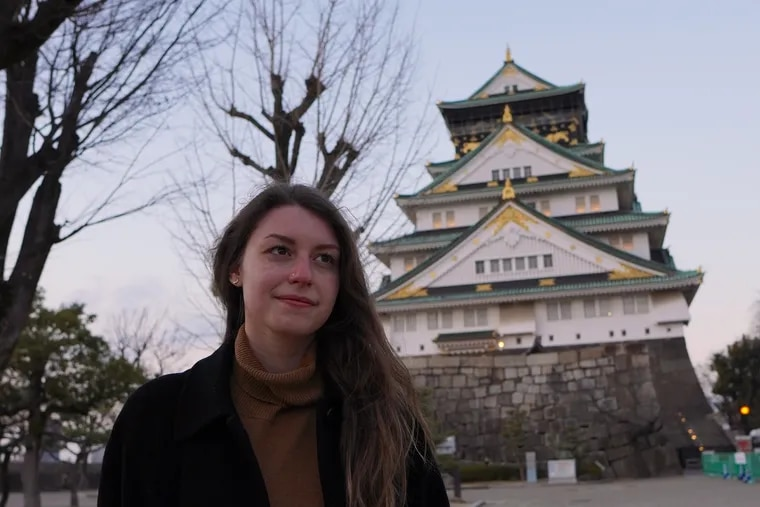 Emily Wilson, a Temple University senior from Philadelphia, is studying in Japan this semester. With fewer tourists, she's been able to visit a lot of attractions with no waiting. Here she is pictured in front of Osaka Castle.