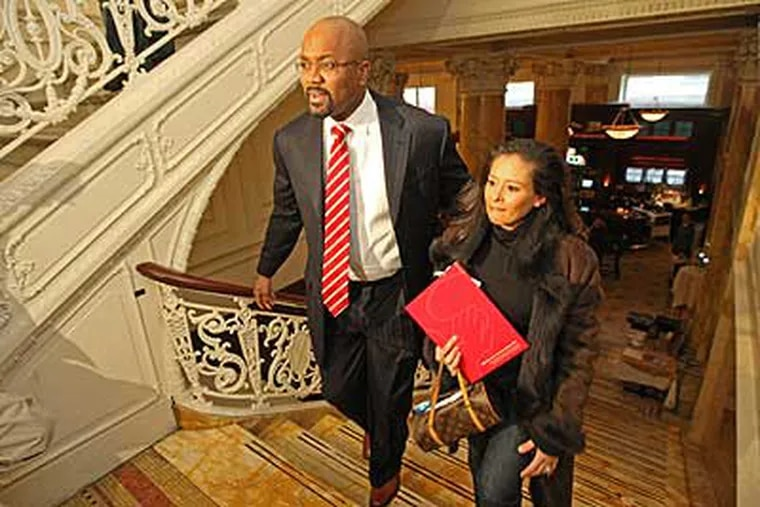 Billy King arriving at the Palm restaurant Wednesday with his wife, Melanie, ready to sit down with rerporters.