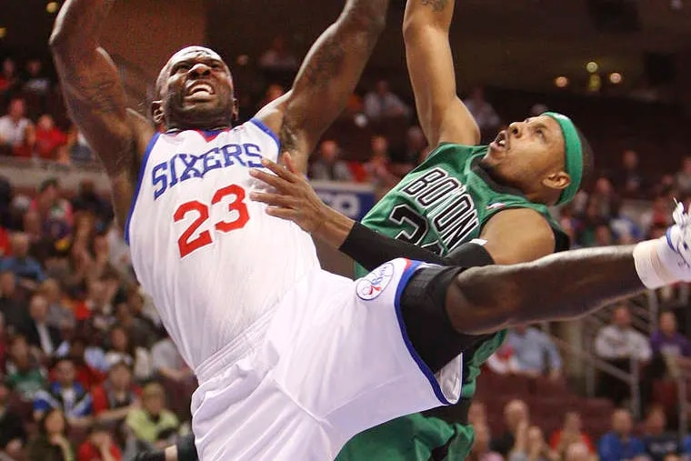 Boston's Paul Pierce fouls the 76ers' Jason Richardson in the first quarter. Richardson had 13 points for the Sixers, who won, 95-94 in overtime, on a shot by Evan Turner. STEVEN M. FALK / Staff Photographer
